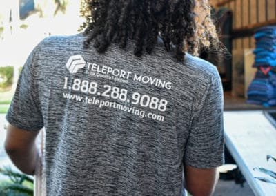 Pictured: A Teleport Moving tshirt with phone number and website.